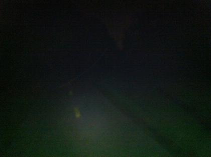 This is an unlit part of the bike trail